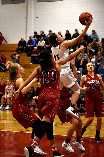 Loveland's (23) Morgan Driscoll goes for a jump shot out of Fairview's (23) Ashley Panem's reach during thier game on Tuesday, Feb. 13, 2018 at Loveland High School in Loveland. Photo by Thieng Mai/Loveland Reporter-Herald.