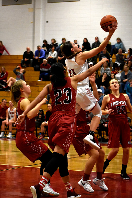 . Loveland\'s (23) Morgan Driscoll goes for a jump shot out of Fairview\'s (23) Ashley Panem\'s reach during thier game on Tuesday, Feb. 13, 2018 at Loveland High School in Loveland. Photo by Thieng Mai/Loveland Reporter-Herald.