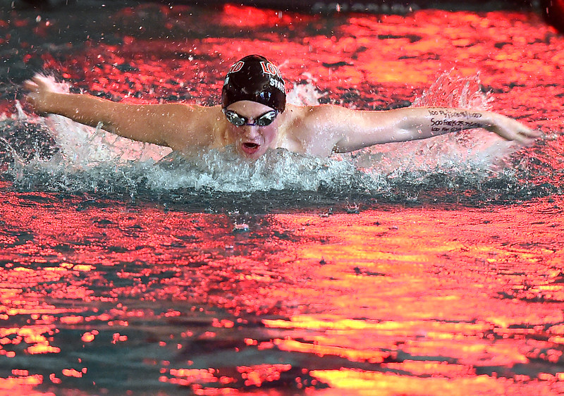 Loveland's Deven Gogarty swims the 100 yard butterfly Tuesday, March 21, 2017, during their meet against Fairview at Loveland High School. (Photo by Jenny Sparks/Loveland Reporter-Herald)