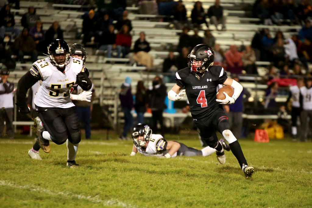 . Loveland�s (4) runs with the ball as Fort Collins goes after him on FRiday night�s game on Oct. 12, 2018 at Patterson Stadium in Loveland. Photo by Taelyn Livingston/ Loveland Reporter-Herlad