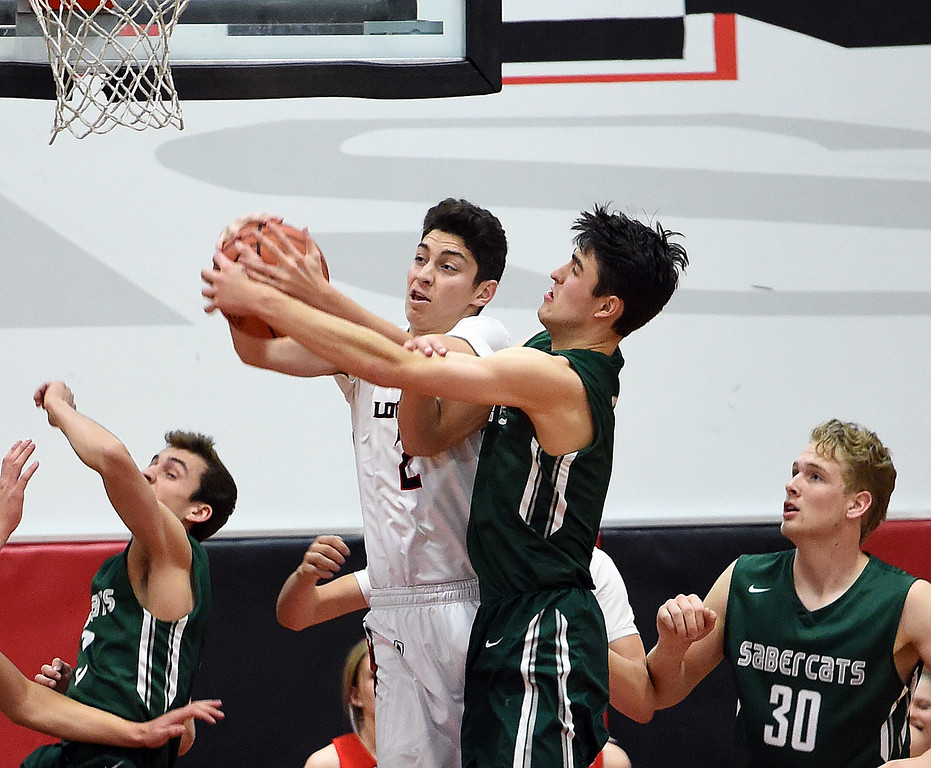 . Loveland\'s (2) Avery Rembao and Fossil Ridge\'s (5) Brandon Lambrecht go up for a rebound during their game Tuesday, Jan. 9, 2018, at Loveland High School.  (Photo by Jenny Sparks/Loveland Reporter-Herald) 2 5