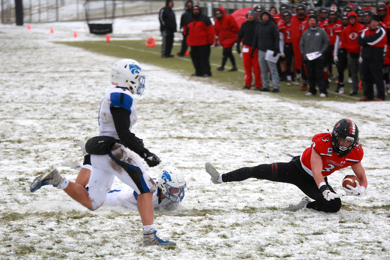 Loveland's (3) defends the ball as Fruita Monument's (4) Max Belshe and (11) Landon Brown go after him during Saturday's playoff game on Nov. 17, 2018 at Ray Patterson Stadium in Loveland, Colo.<br /> Photo by Taelyn Livingston/ Loveland Reporter-Herald