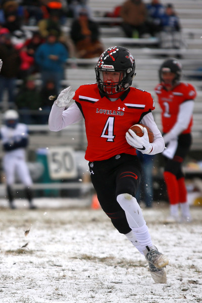 Loveland's (4) Cody Rakowsky runs with the ball on Saturday's playoff game on Nov. 17, 2018 against Fruita Monument at Ray Patterson Stadium in Loveland, Colo.<br /> Photo by Taelyn Livingston/ Loveland Reporter-Herald