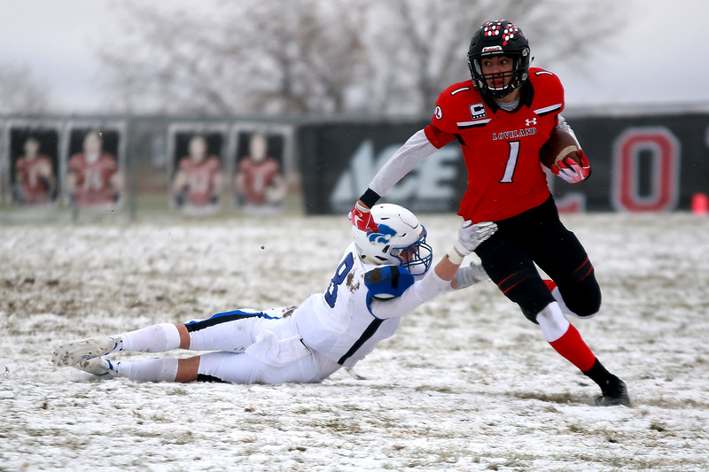 Loveland's (1) Isaiah Meyers defends the ball as Fruita Monument's (8) Jaden Street tries to tackle him during Saturday's playoff game on Nov. 17, 2018 at Ray Patterson Stadium in Loveland, Colo.<br /> Photo by Taelyn Livingston/ Loveland Reporter-Herald