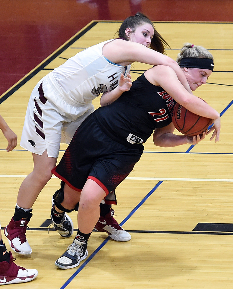 Loveland High's #21 Kenzie Overmiller and Horizon's #33 Savannah Arellano battle for a rebound during their game Tuesday, Feb. 28, 2017, in Thornton. (Photo by Jenny Sparks/Loveland Reporter-Herald)