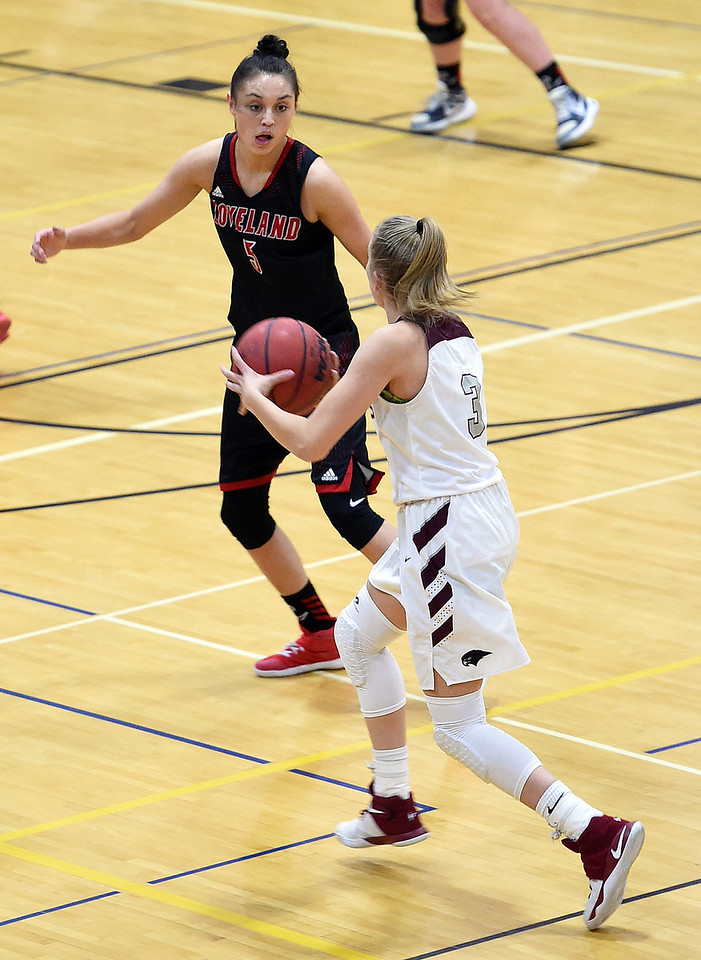 Loveland High's #5 Tatum Rembao stays on Horizon's #3 Kylie Jimenez as she takes the ball down court during their game Tuesday, Feb. 28, 2017, in Thornton. (Photo by Jenny Sparks/Loveland Reporter-Herald)