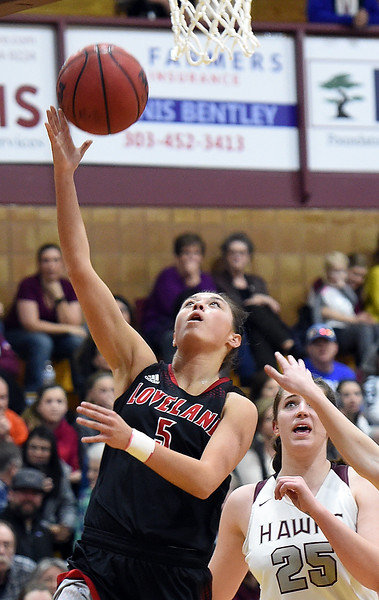 Loveland High's #5 Tatum Rembao goes up for a shot during their game against Horizon High School Tuesday, Feb. 28, 2017, in Thornton. (Photo by Jenny Sparks/Loveland Reporter-Herald)