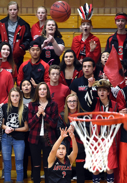 Loveland High's #2 Megan Stackhouse shoots as fans watch during their game against Horizon High School Tuesday, Feb. 28, 2017, in Thornton. (Photo by Jenny Sparks/Loveland Reporter-Herald)