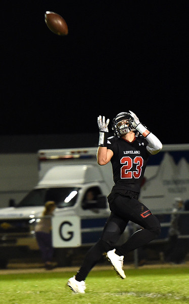 Loveland High's (23) Caleb Smith catches a touchdown pass Friday, Sept. 29, 2017, during their game against Mountain View at Patterson Stadium in Loveland. (Photo by Jenny Sparks/Loveland Reporter-Herald)