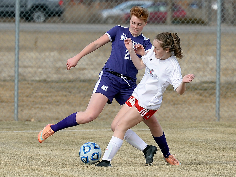 Mountain View's Sadie Porter and Loveland's Abby Amschwand try to get control of the ball during their soccer game Tuesday, March 12, 2019, at Mountain View High School in Loveland.  (Photo by Jenny Sparks/Loveland Reporter-Herald