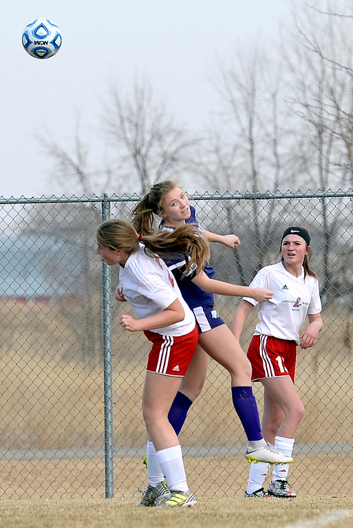 . Mountain View\'s Peyton Oleson and Loveland\'s Lindsay Spence go up for a header during their soccer game Tuesday, March 12, 2019, at Mountain View High School in Loveland.  (Photo by Jenny Sparks/Loveland Reporter-Herald)