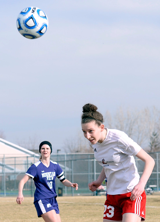 . Loveland\'s Grace Parks hits a header during their soccer game against Mountain View Tuesday, March 12, 2019, at Mountain View High School in Loveland.  (Photo by Jenny Sparks/Loveland Reporter-Herald)