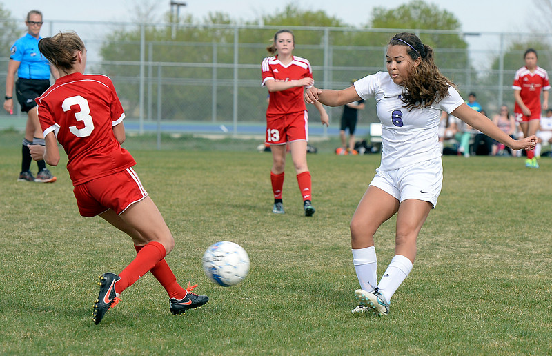 Mountain View's #6 Sarai Castellanos and Loveland's #3 Josie Fugate go for the ball Monday, April 17, 2017, during their game at Mountain View High School.   (Photo by Jenny Sparks/Loveland Reporter-Herald)