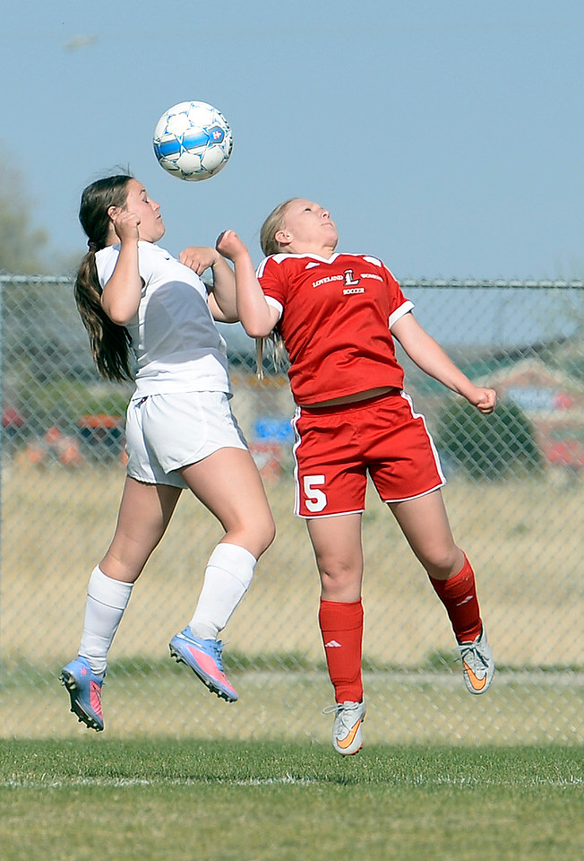 Mountain View's #1 Sammi Cheesman and Loveland's #5 Tessa Madsen go up for a header Monday, April 17, 2017, during their game at Mountain View High School.   (Photo by Jenny Sparks/Loveland Reporter-Herald)L5 M1