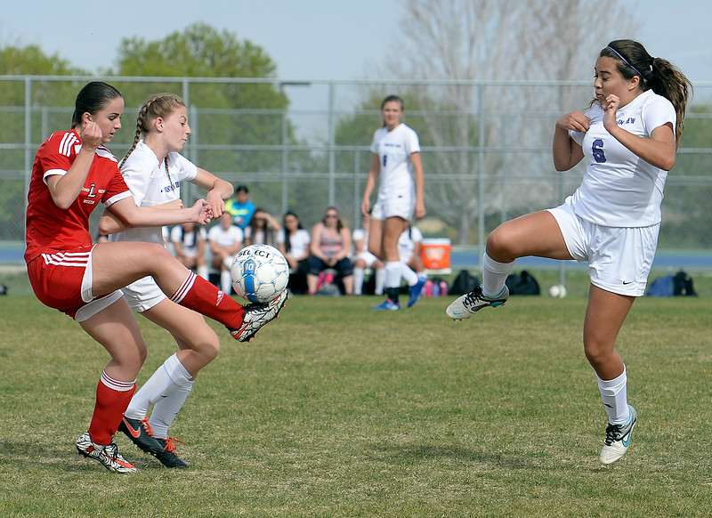 Mountain View's #6 Sarai Castellanos and #7 Jacey Paoli and Loveland's #Alex Norris go for the ball Monday, April 17, 2017, during their game at Mountain View High School.   (Photo by Jenny Sparks/Loveland Reporter-Herald)