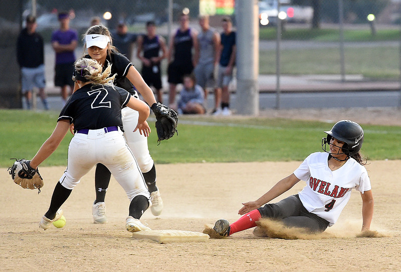 Loveland's (4) Emma Duran slides into second as Mountain View's (2) Kamryn Leoffler tries to catch the ball during their game Friday, Aug, 24, 2018, at Centennial Field in Loveland.  (Photo by Jenny Sparks/Loveland Reporter-Herald)