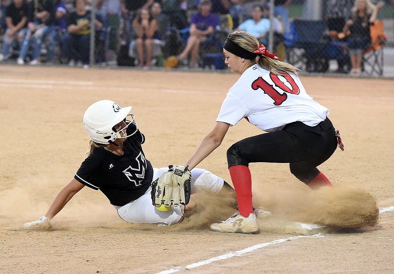 Mountain View's (2) Kamryn Loeffler slides into third as Loveland's (10) Sage Baldwin tries to tag her out during their game Friday, Aug, 24, 2018, at Centennial Field in Loveland.  (Photo by Jenny Sparks/Loveland Reporter-Herald)