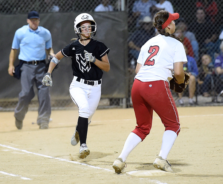 Mountain View's (8) Jaycee Schroeder runs to first base  as Loveland's (2) Elana Gerhard waits for the ball Wednesday, Sept. 6, 2017, during their game at Centennial Park in Loveland.   (Photo by Jenny Sparks/Loveland Reporter-Herald)