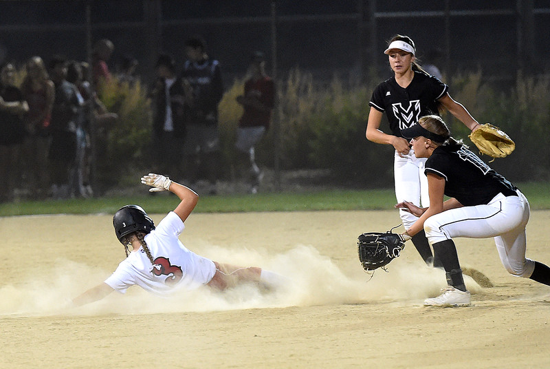 Loveland's (3) Ryley Long slides into third as Mountain View's (11) Peyton Duke waits for the ball Wednesday, Sept. 6, 2017, during their game at Centennial Park in Loveland.   (Photo by Jenny Sparks/Loveland Reporter-Herald)