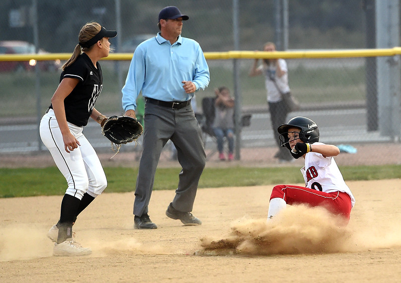 Loveland's (10) Jessi Case slides into third as Mountain View's (11) Peyton Duke waits for the ball Wednesday, Sept. 6, 2017, during their game at Centennial Park in Loveland.   (Photo by Jenny Sparks/Loveland Reporter-Herald)