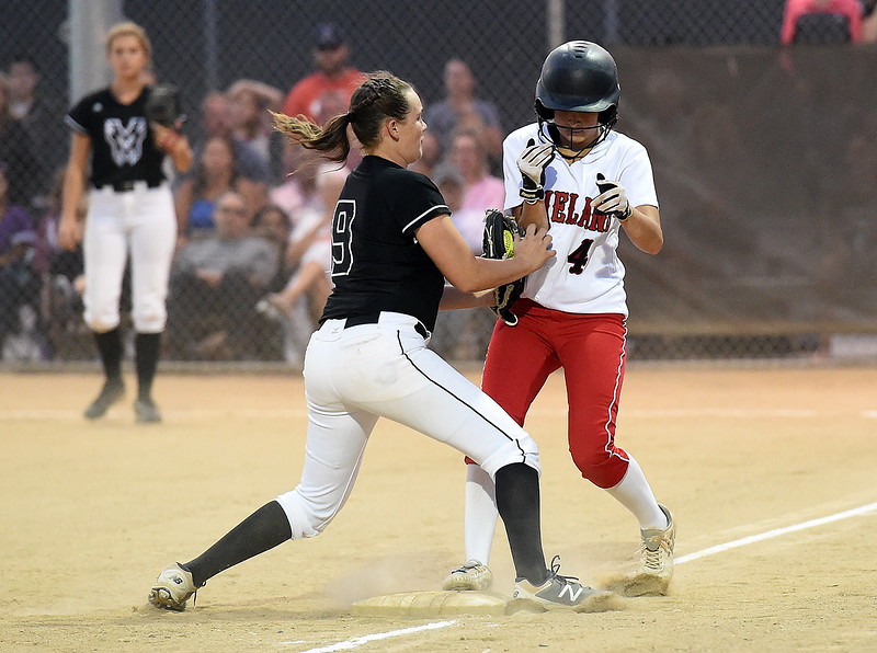 Loveland's (4) Katie McClain tries to get back to third base as Mountain View's (9) RaLeigh Basart tries to tag her out Wednesday, Sept. 6, 2017, during their game at Centennial Park in Loveland.    (Photo by Jenny Sparks/Loveland Reporter-Herald)