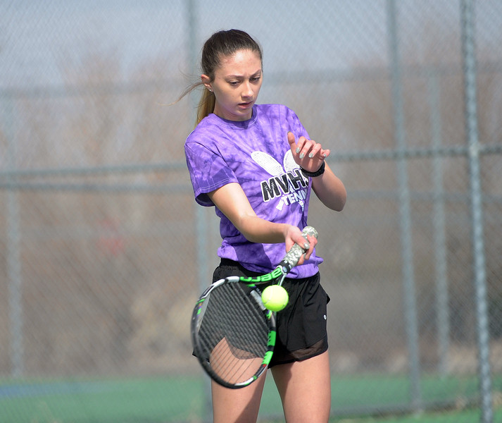 Mountain View's Kendall Krieger connects with a ball against Loveland's Rebecca Emme at Mountain View's tennis courts on Tuesday, March 26. The Indians wons the match 7-0. (Colin Barnard/Loveland Reporter-Herald)