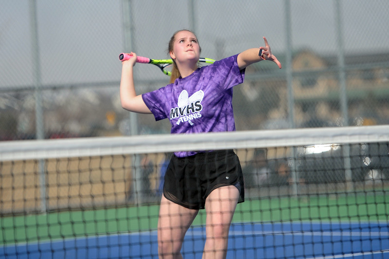 Mountain View's Audra Axline hits an overhead shot against Loveland's Beilynn Geise at Mountain View's tennis courts on Tuesday, March 26. The Indians wons the match 7-0. (Colin Barnard/Loveland Reporter-Herald)