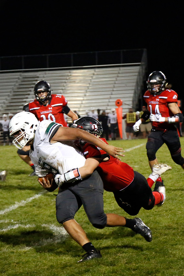 Loveland's Colby Mauck (6) tackles Niwot's Eric Ruiz (9) at the 20-yard line on Thursday, Oct. 12, 2017 at Patterson field. (Photo by Lauren Cordova/Loveland Reporter-Herland)