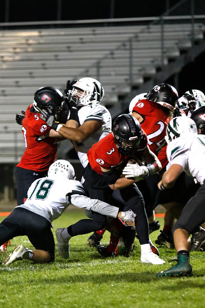 Loveland's Zachary Weinmaster  (3) steps over the goal line as Niwot's Brandon Barton (18) tries to stop him on Thursday, Oct. 12, 2017 at Patterson field. (Photo by Lauren Cordova/Loveland Reporter-Herland)
