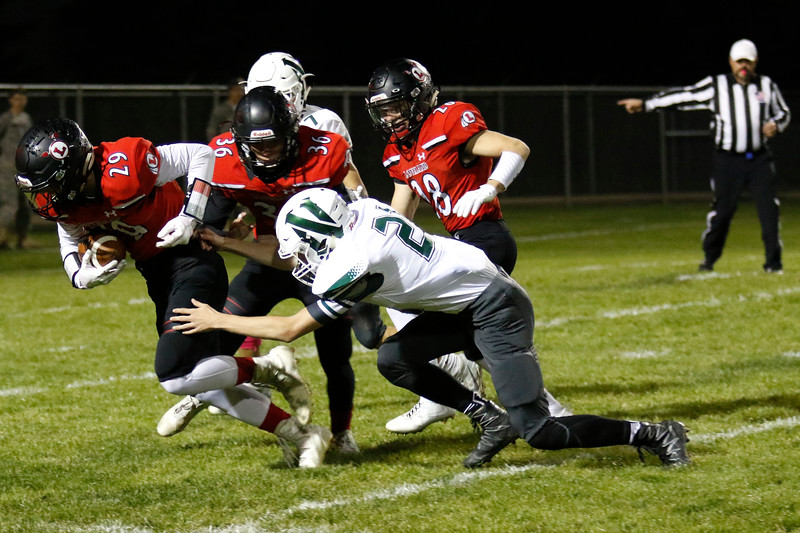 Loveland's Michael Lewis (29) picks up a fumbled ball at the 10-yard line as Niwot's Dylan Beal (21) tries to tackle him, with Joseph Bork (36) and Cody Donovan (28) on defense, Lewis goes on to score a touchdown on Thursday, Oct. 12, 2017 at Patterson field. (Photo by Lauren Cordova/Loveland Reporter-Herland)