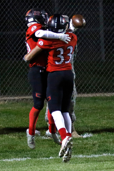Loveland's Joseph Bork (26) celebrates his touchdown with Marcelo Espinoza-Diaz (33) on Thursday, Oct. 12, 2017 at Patterson field. (Photo by Lauren Cordova/Loveland Reporter-Herland)
