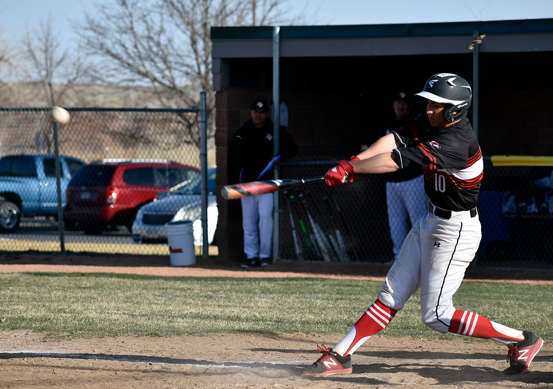 Loveland's (10) Keegan Villarreal successfully hits a fast pitch from Prairie View during their game on Tuesday, April 3, 3018 at Centennial Baseball Complex in Loveland. Photo by Thieng Mai/Loveland Reporter-Herald.