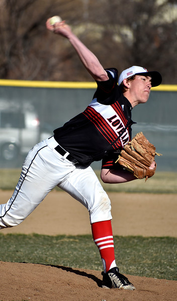 Loveland's (18) Kyle Irwin pitches to strike out Prairie View 's batter during their game on Tuesday, April 3, 2018 at Centennial Baseball Complex in Loveland. Photo by Thieng Mai/Loveland Reporter-Herald.