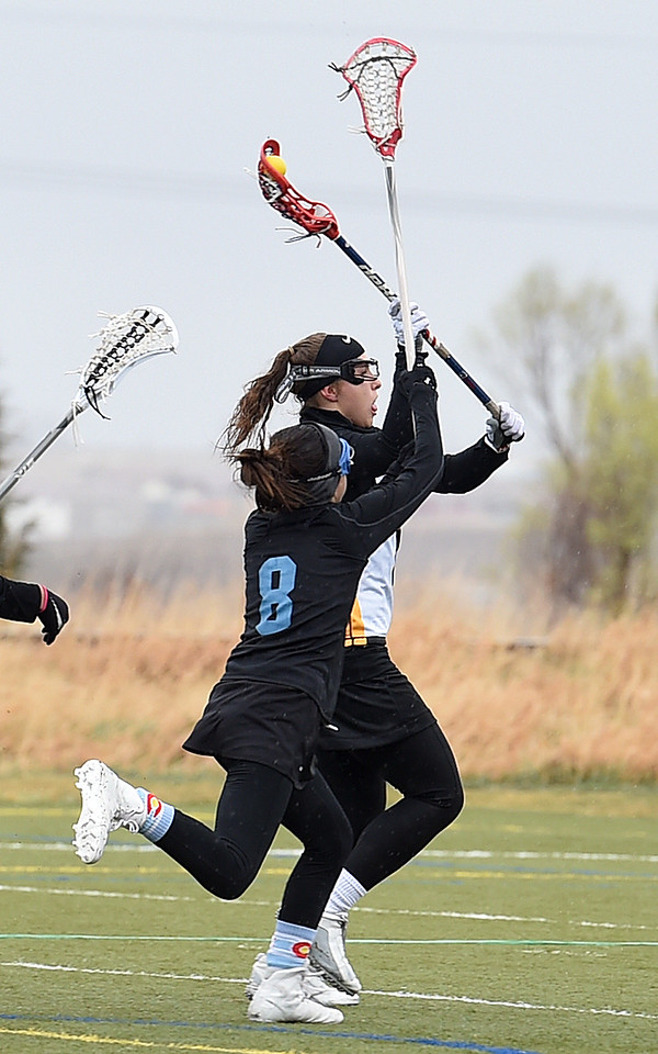 Thompson Valley's #23 Logan Derock winds up to shoot as Pueblo West's #8 Marissa Macaluso tries to block during their game Tuesday, March 28, 2017, at Loveland Sport Park in Loveland. (Photo by Jenny Sparks/Loveland Reporter-Herald)