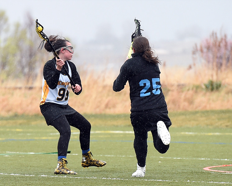 Thompson Valley's #99 Courtney MacEwen winds up to shoot past Pueblo West's #25 Natalie Blood during their game Tuesday, March 28, 2017, at Loveland Sport Park in Loveland. (Photo by Jenny Sparks/Loveland Reporter-Herald)