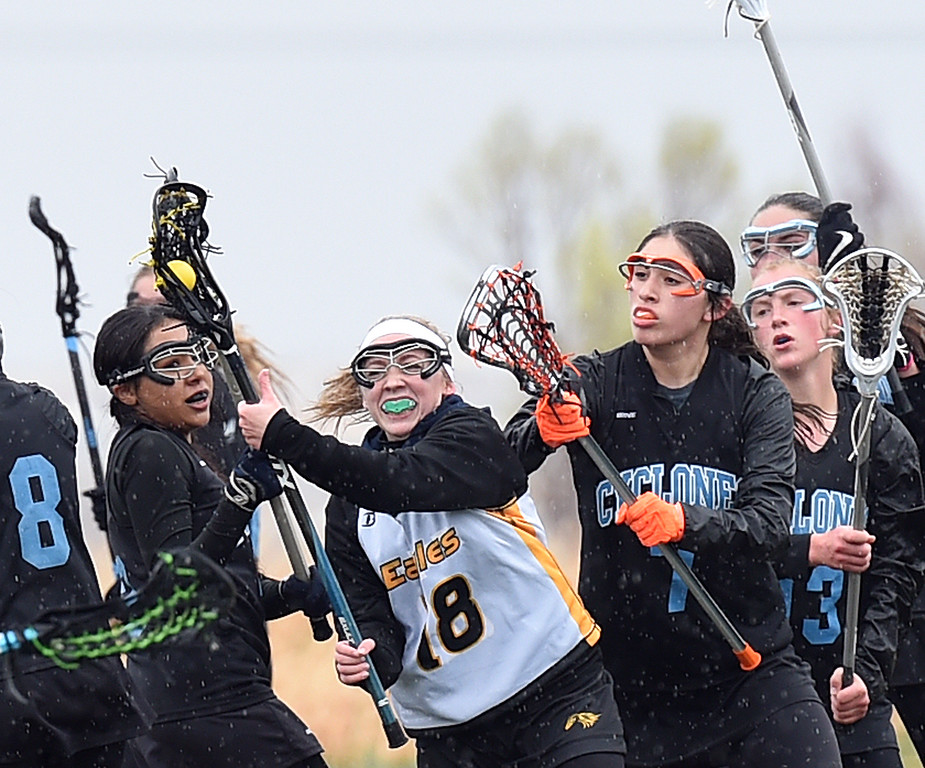 Thompson Valley's #18 Sydnie Wagonmaker gets past a pack of Pueblo West players Tuesday, March 28, 2017, at Loveland Sport Park in Loveland. (Photo by Jenny Sparks/Loveland Reporter-Herald)