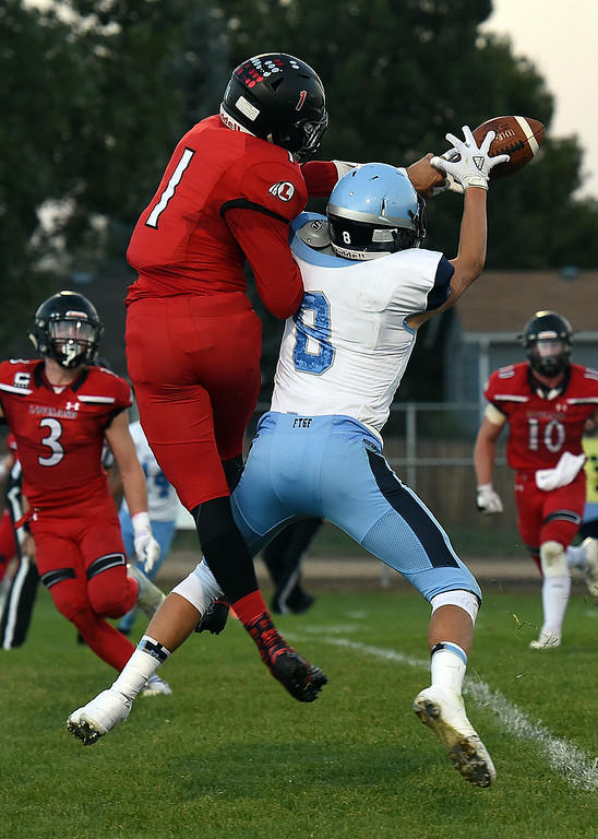 . Loveland\'s (1) Isaiah Meyers tries to block a pass to Ralston Valley\'s (8) JJ Galbreath during their game Wednesday, Sept. 12, 2018, at Patterson Stadium in Loveland.   (Photo by Jenny Sparks/Loveland Reporter-Herald)