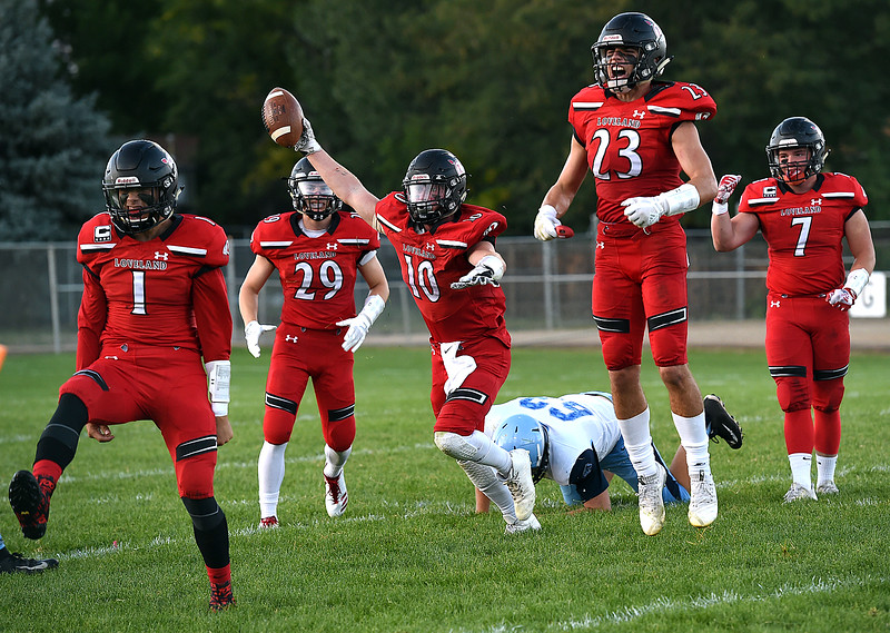 Loveland's (10) Sean Boylan and teammates celebrate a fumble recovery during their game against Ralston Valley Wednesday, Sept. 12, 2018, at Patterson Stadium in Loveland.   (Photo by Jenny Sparks/Loveland Reporter-Herald)