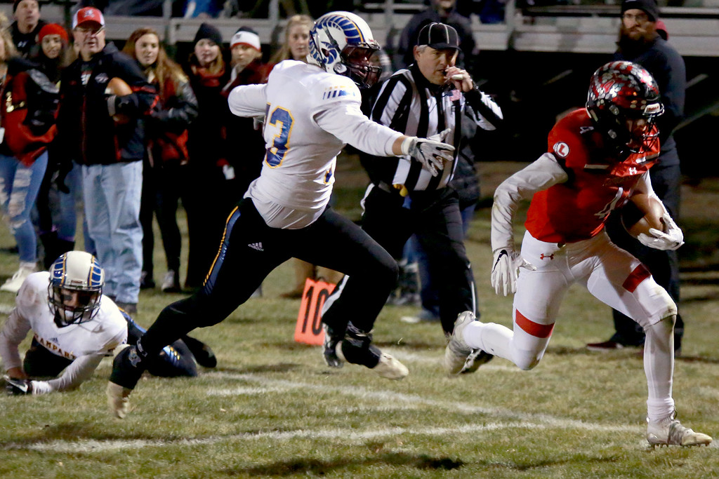 . Loveland�s (4) Cody Rakowski runs for the end-zone during Friday night�s playoff game against Rampart on Nov. 9, 2018 at Ray Patterson Stadium in Loveland, Colo.Photo by Taelyn Livingston/ Loveland Reporter-Herald.