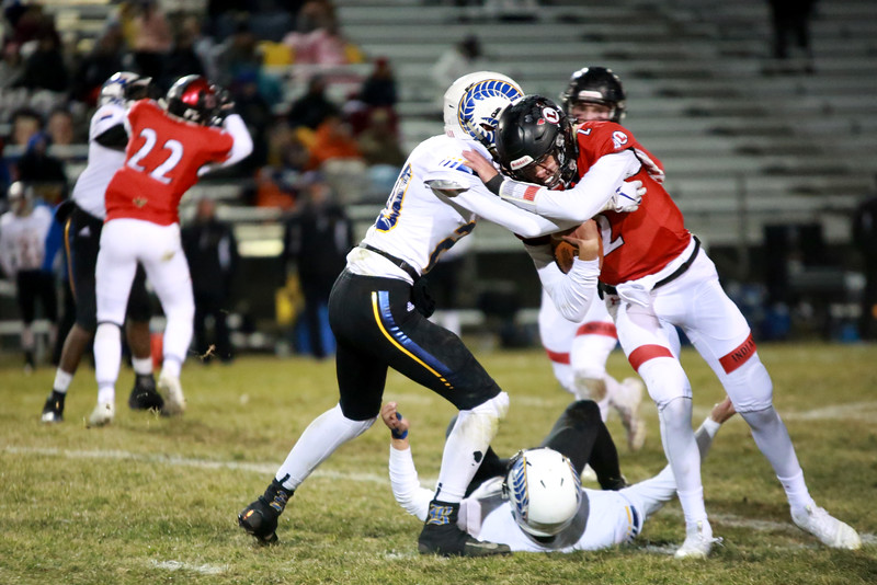 Loveland's (2) Riley Kinney defends the football from Rampart's (20) Luke Pavlica during Friday night's playoff game on Nov. 9, 2018 at Ray Patterson Stadium in Loveland, Colo.<br /> Photo by Taelyn Livingston/ Loveland Reporter-Herald.
