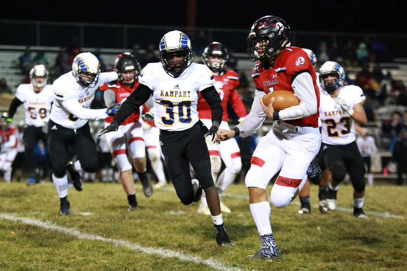 Loveland's (1) Isaiah Meyers defends the ball during Friday night's playoff game as Rampart's (30) Julius Marcano goes after him on Nov. 9, 2018 at Ray Patterson Stadium in Loveland, Colo.<br /> Photo by Taelyn Livingston/ Loveland Reporter-Herald.