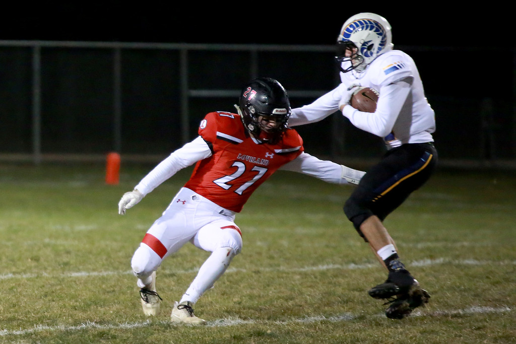 . Loveland�s (27) Cody Donovan plays defense as Rampart�s (12) Kevin Witcher plays offense during Friday night�s playoff game on Nov. 9, 2018 at Ray Patterson Stadium in Loveland, Colo.Photo by Taelyn Livingston/ Loveland Reporter-Herald.