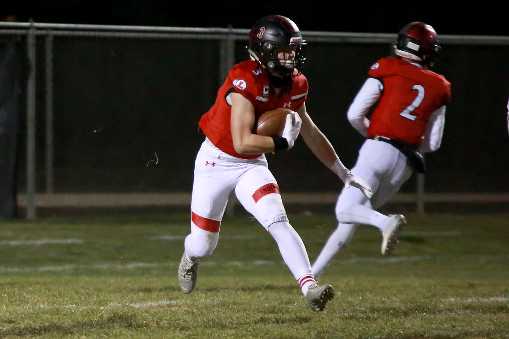 . Loveland�s (3) Zach Weinmaster runs with the ball during Friday night�s playoff game against Rampart on Nov. 9, 2018 at Ray Patterson Stadium in Loveland, Colo.Photo by Taelyn Livingston/ Loveland Reporter-Herald.