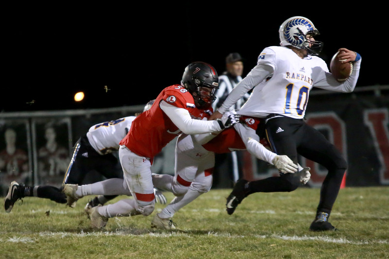 Loveland's (58) Michael Deschene goes to tackle Rampart's (10) Cale Cormaney during Friday night's playoff game on Nov. 9, 2018 at Ray Patterson Stadium in Loveland, Colo.<br /> Photo by Taelyn Livingston/ Loveland Reporter-Herald.