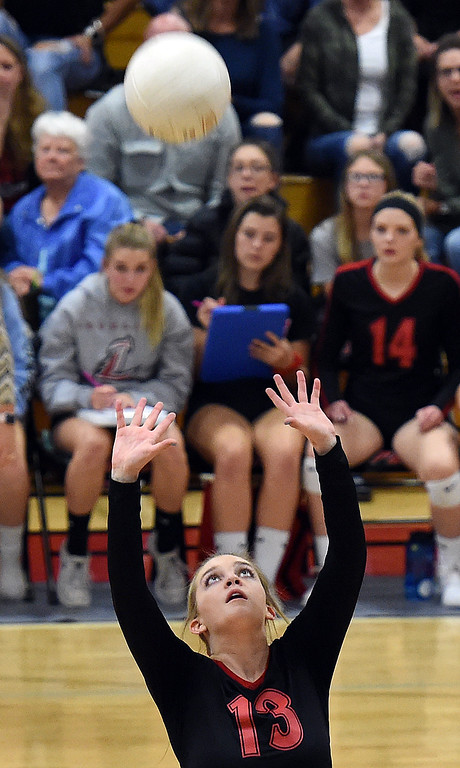 . Loveland\'s (13) Eliana Martin sets the ball during their game against Rocky Mountain on Thursday, Oct. 18, 2018, at Loveland High School.  (Photo by Jenny Sparks/Loveland Reporter-Herald)