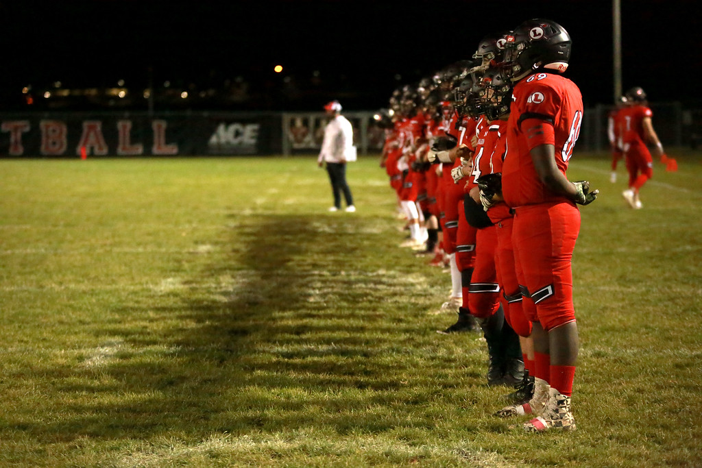. The Loveland Indians stand together during the coin flip at the beginning of their game against the Skyline Falcons at Ray Patterson Stadium on Nov. 2, 2018 in Loveland, Colo.