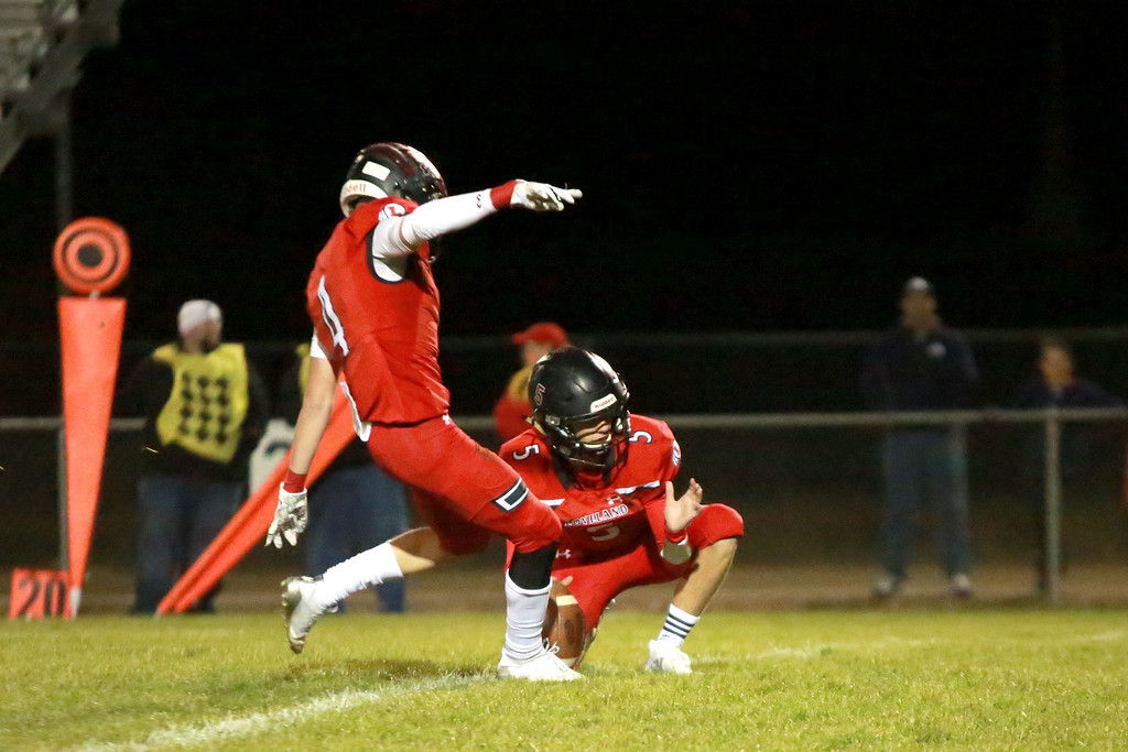 . Loveland�s (4) Cody Rakowsky and (5) Zack Rakowsky go for the extra point after a touchdown at their game against Skyline High School at Ray Patterson Stadium on Nov. 2, 2018 in Loveland, Colo.