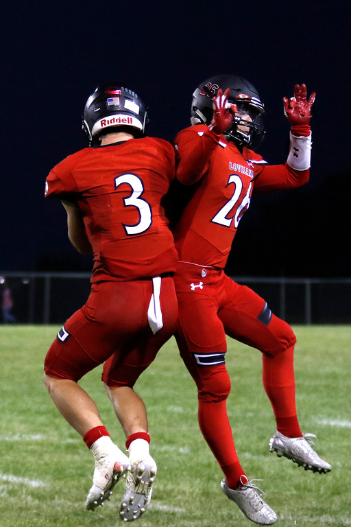 . Loveland�s Zach Weinmaster (3) and Joseph Bork (26) celebrate after Weinmaster scored the third touchdown Friday. Sept. 8, 2017 at Patterson Stadium in Loveland. (Photo by Lauren Cordova/Loveland Reporter-Herald)