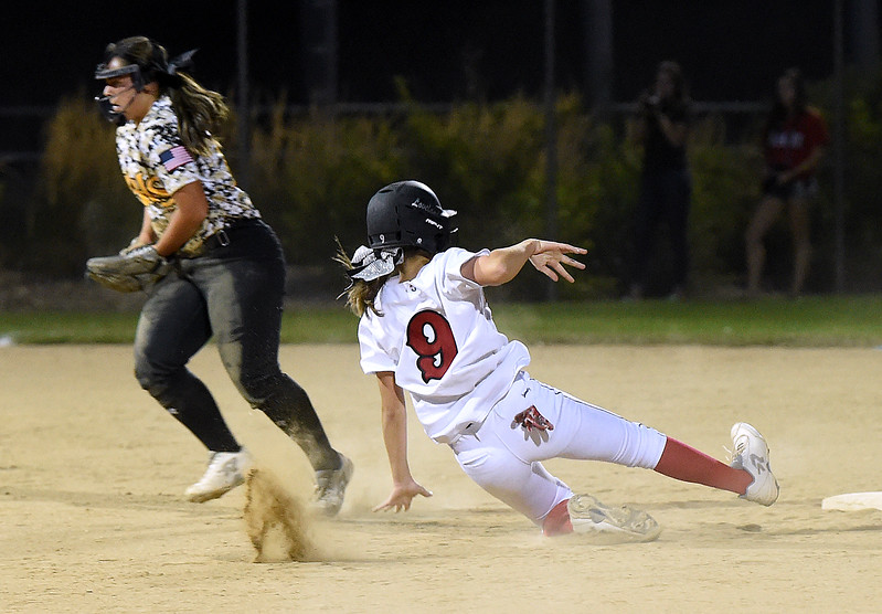 Loveland High's (9) Sage Baldwin slides into second base Tuesday, Sept. 12, 2017,  during their game against Thompson Valley at Centennial Park in Loveland.  (Photo by Jenny Sparks/Loveland Reporter-Herald)
