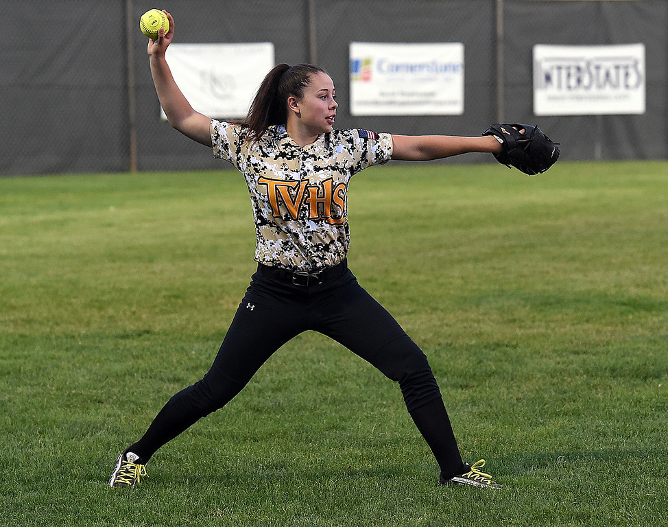 Thompson Valley's (5) Olivia Coronado throws the ball Tuesday, Sept. 12, 2017, during their game against Loveland High at Centennial Park in Loveland.  (Photo by Jenny Sparks/Loveland Reporter-Herald)5